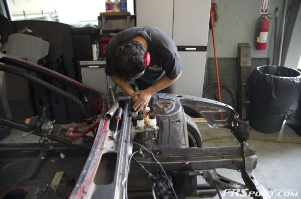 Chris working on some extra bracing after cutting my wheel wells out.